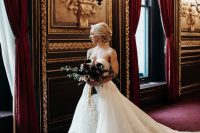 a very refined transformable wedding dress – a strapless lace mermaid one with an additonal skirt