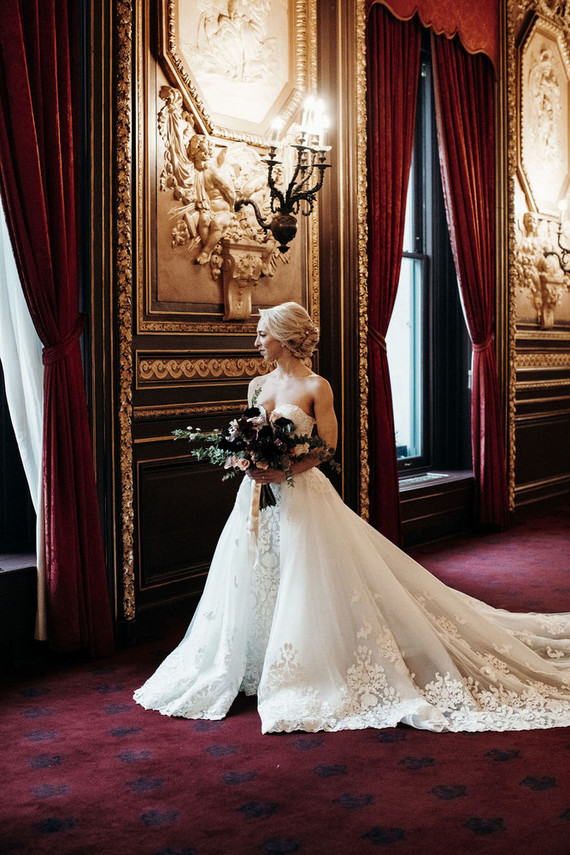 a very refined transformable wedding dress   a strapless lace mermaid one with an additonal skirt