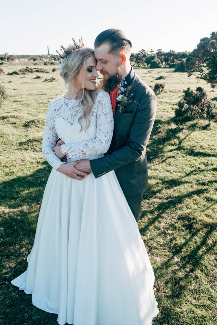 an A-line wedding gown with a lace bodice with long sleeves and a full plain skirt
