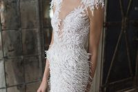 an illusion neckline wedding dress with fringe looks very playful and reminds of snow flakes