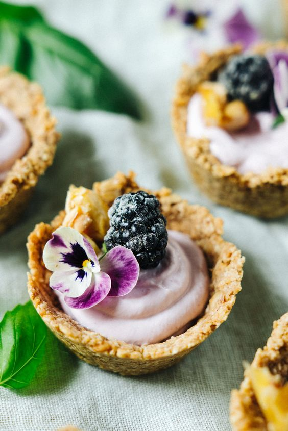 mini blackberry cheesecake tarts with walnut crust are delicious and adorable for a modern wedding