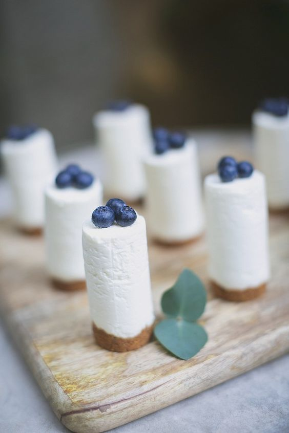mini blueberry cheesecakes can be an addition to a larger cake on your dessert table