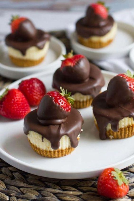 mini cheesecakes topped with chocolate and with fresh strawberries are very tasty and feature a classic taste