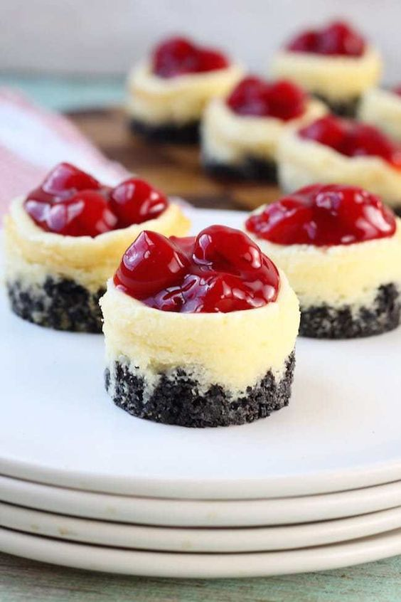 mini cheesecakes with chocolate bases and cherry compote on top are delicious and very sweet