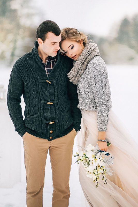 tan pants, a dark plaid shirt and a graphite grey cardigan for a casual and very comfortable winter groom's look