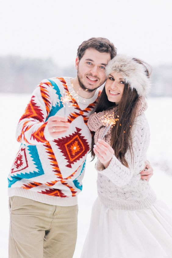 tan pants and a bold printed sweater for a casual outdoor winter wedding   this sweater will make you stand out in the snow
