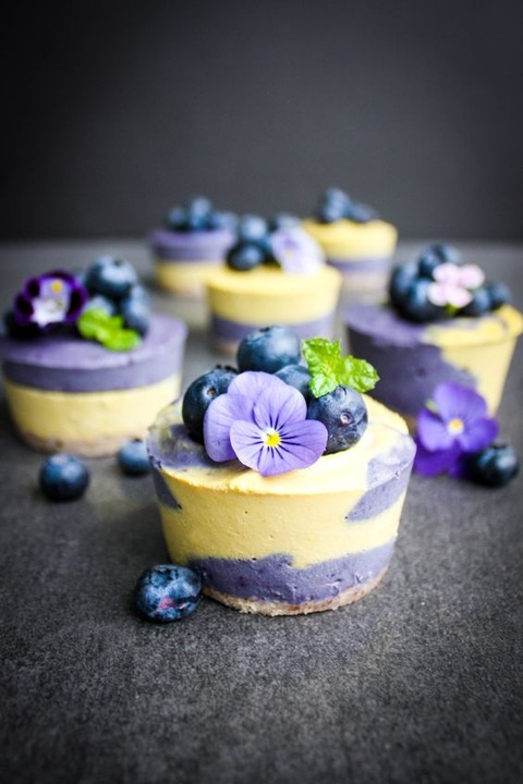 vegan mini cheesecakes topped with berries and flowers are a delicious dessert for a summer wedding