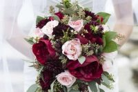 a beautiful and textural wedding bouquet with marsala and blush blooms, greenery, blackberries is a beautiful idea for a summer bride