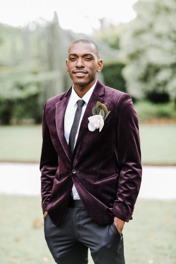 a bold look with a purple velvet blazer, a black tie, black pants and a white shirt for a fall or winter wedding