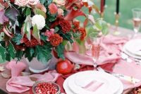 a bright fall wedding table with pink and marsala runners, a colorful floral centerpiece with marsala and blush blooms, marsala and black candles