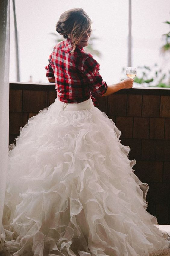 a flannel shirt as a coverup is a great idea for a rustic bride and it looks cool with your wedding gown