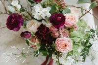 a gorgeous fall wedding bouquet of marsala, blush, white blooms, greenery and twigs is a lovely idea to rock