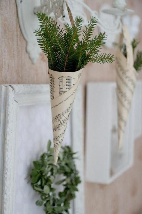 a greenery wreath and evergreens in paper cones make the wedding aisle look vintage, natural and chic