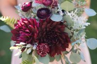a lovely wedding bouquet with marsala blooms and greenery is a gorgeous idea both for a bride and a bridesmaid
