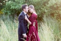a marsala wedding separate with a crop top with ties on the back and a pleated maxi skirt with a train will make a statement