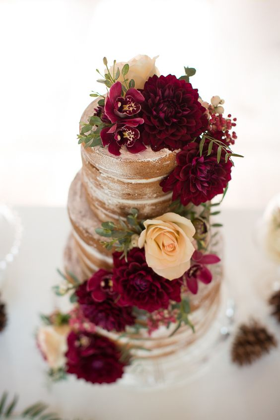 a naked wedding cake topped with marsala and neutral blooms and greenery will fit a summer or a fall wedding easily