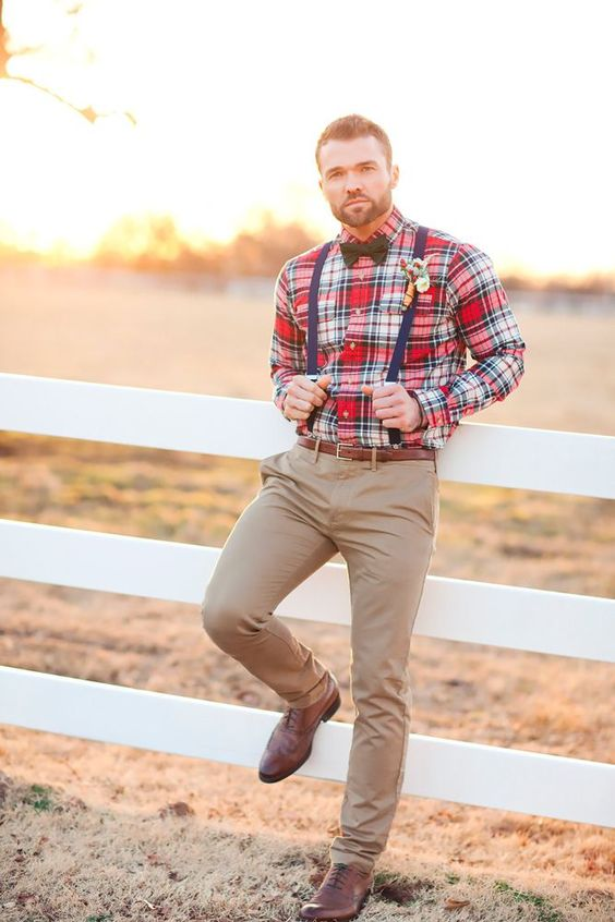 a plaid red shirt, navy suspenders, tan pants, brown shoes and a green bow tie for a relaxed rustic look