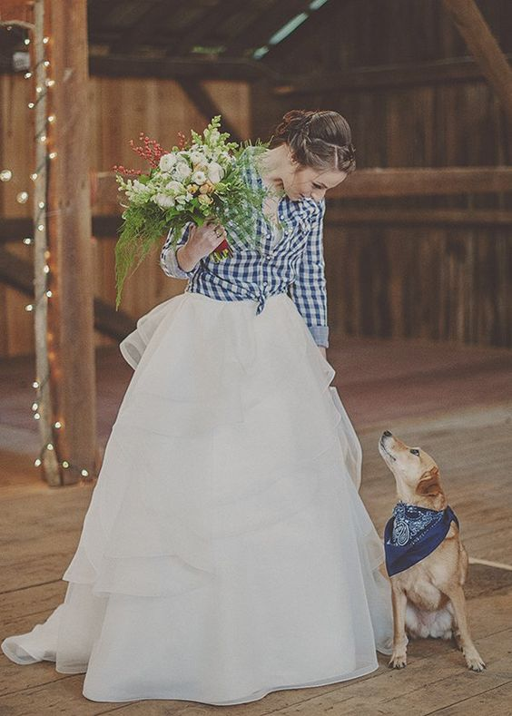 a plaid shirt over the wedding dress is a stylish coverup idea to rock, perfect for a rustic wedding
