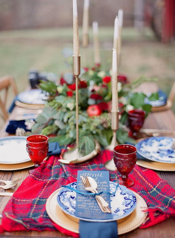 a plaid wedding table runner will add coziness to your tablescape and here it contrasts the blues and greenery