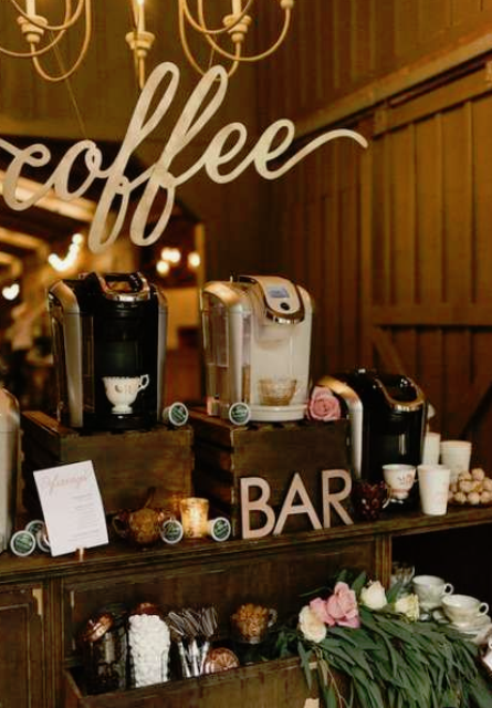 a rustic vintage hot chocolate and coffee bar made of an old dresser and some elegant cups and greenery and blooms