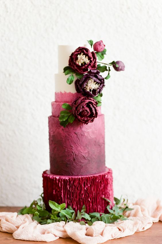 a unique wedding cake with marsala textural tiers and a color block one, with bold sugar and natural blooms is amazing for the fall
