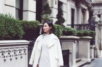 all-white outfit with a lace midi dress, ankle booties and a warm coat for a bride-to-be