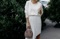 blush heels, a pleated asymmetrical skirt, a white top and a mauve bag for a modern bride-to-be