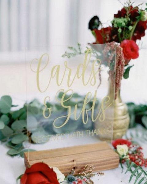 go for lush red and burgundy blooms and greenery to decorate your winter bridal shower