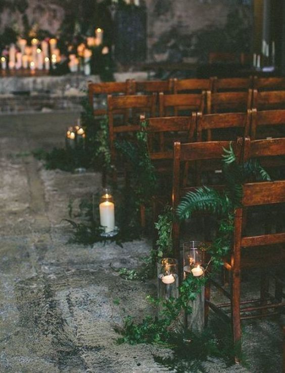 greenery and ferns, floating candles in tall vases make the wedding space natural and stylish