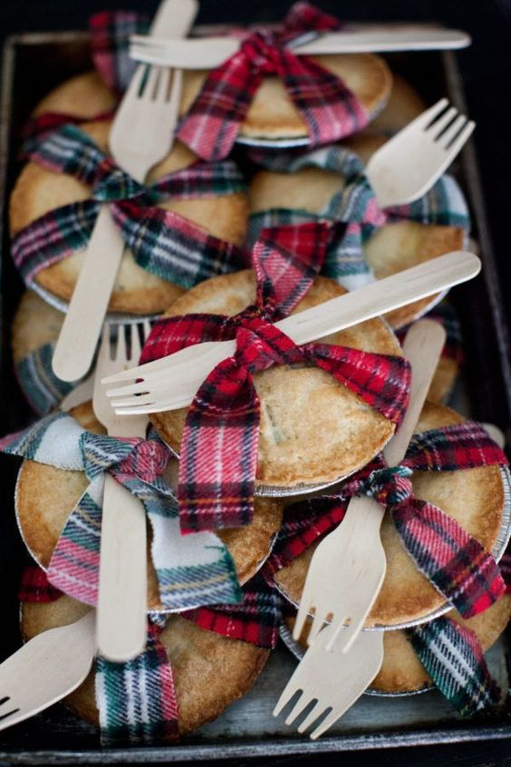 home pies with plaid ribbons and wooden forks are cool wedding favors or camp wedding desserts