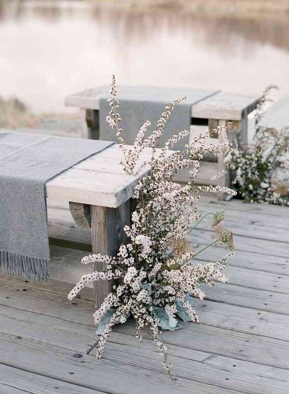 lush blooming branches and pale greenery create a frozen feel in your wedding ceremony space