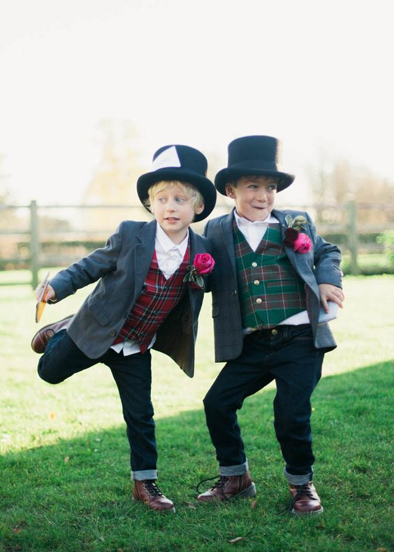 ring bearers wearing jeans, grey blazers and bright tartan waistcoats and hats for a bold and cool look