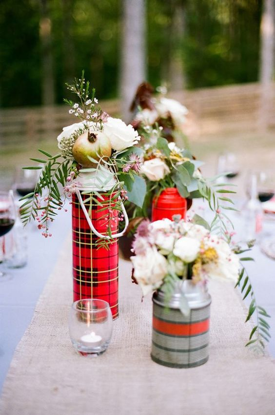 rustic winter table styling with plaid thermoses and white blooms and greenery plus candles is very cozy