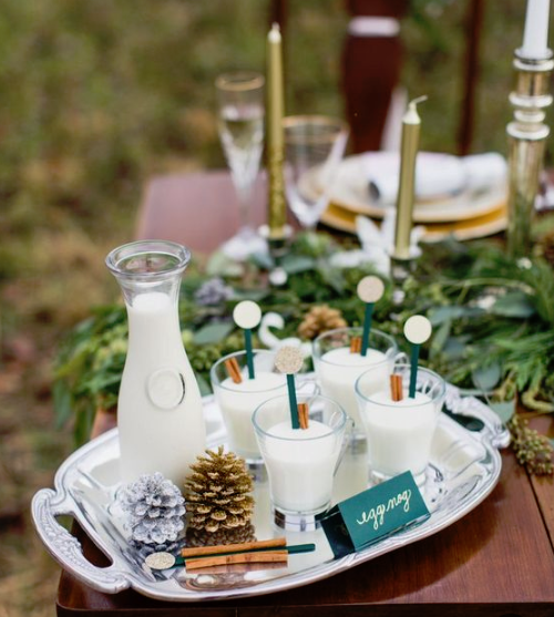 winter cocktails with cinnamon, pinecones and cinnamon sticks on an elegant silver tray