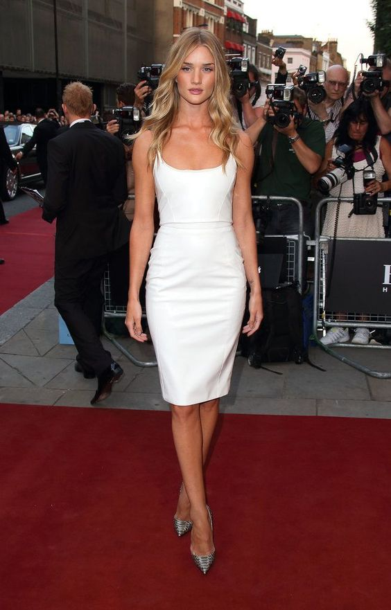 Rosei Huntington Whiteley wearing a beautiful and simple white fitting knee dress with a deep neckline and silver pumps