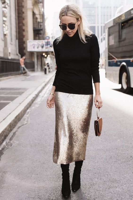 a black turtleneck, a gold sequin pencil midi, black sock booties and a brown bag with a ring handle
