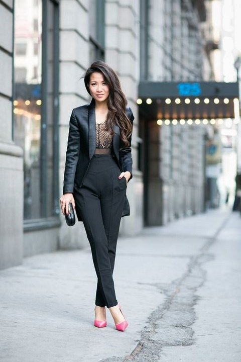 a black tux, a black lace bodysuit, pink shoes and a shiny black clutch for a bold statement