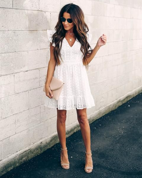 a boho lace A-line mini dress with ruffle cap sleeves, a V-neckline, nude shoes and a blush clutch as a getaway look