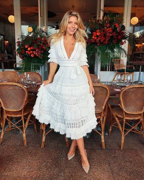 a boho lace and ruffle A-line midi dress with a deep V-neckline, short sleeves and a sash for a romantic bride