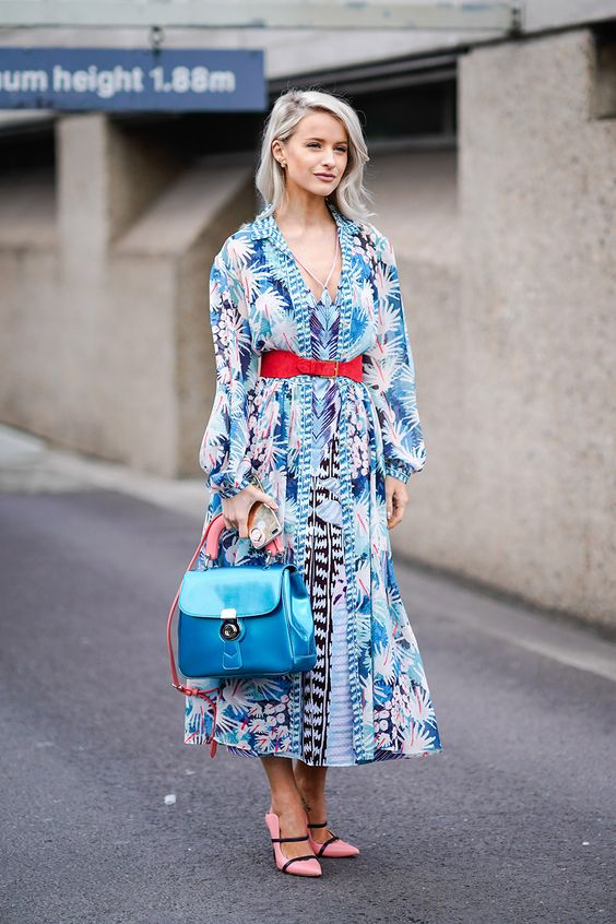 a bright blue midi printed dress, a red belt, pink shoes for a colorful spring wedding