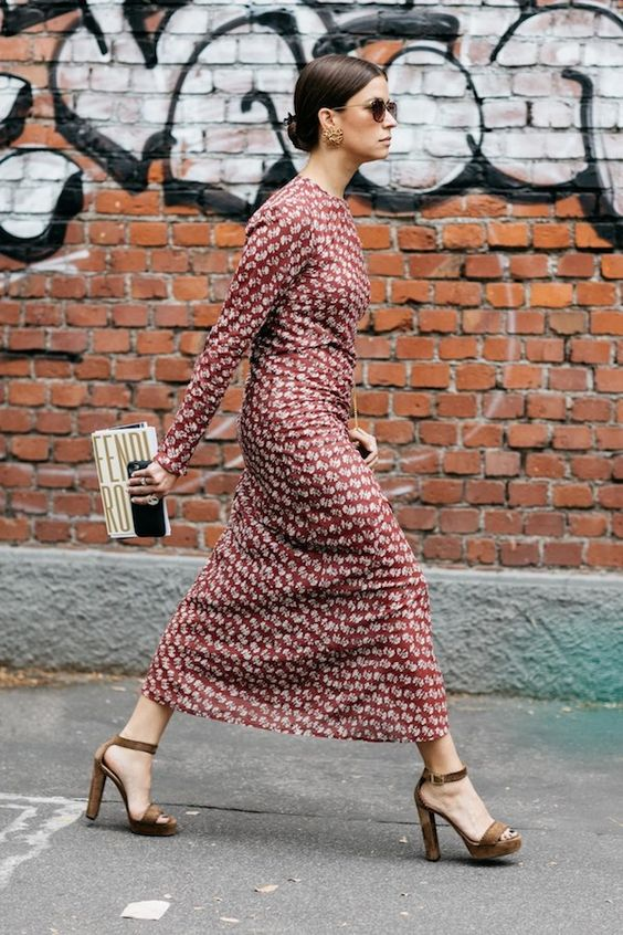 a chic burgundy printed midi dress with long sleeves, a high neckline, brown platform shoes and a whimsy clutch