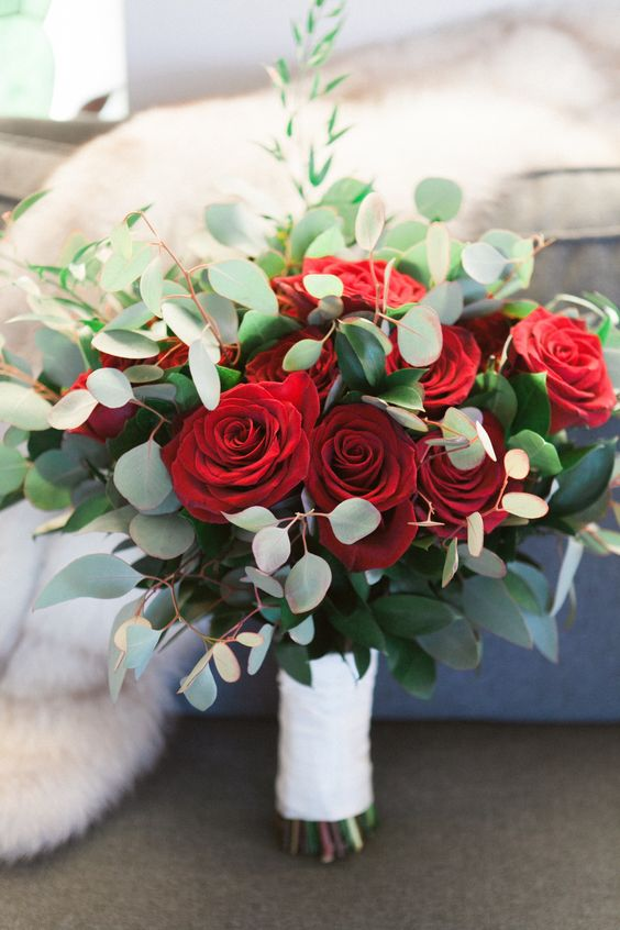 a classic wedding bouquet with red roses and eucalyptus is a lovely solution not only for a Valentine's bride
