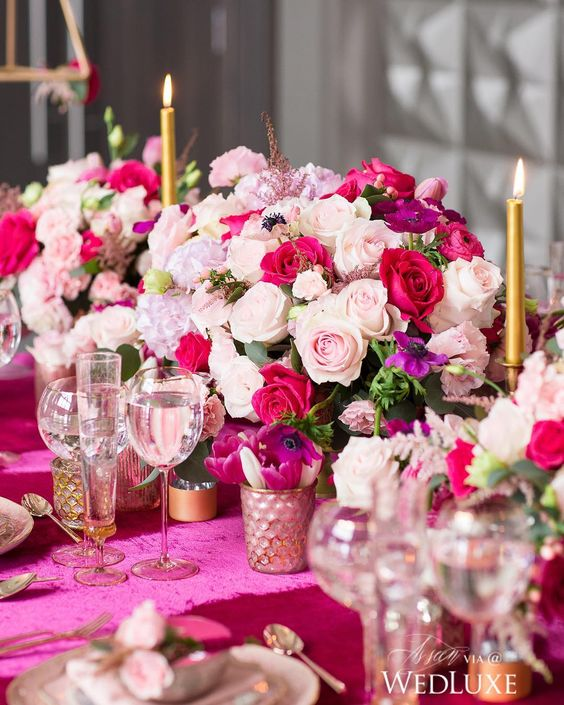 a colorful floral centerpiece of light pink, fuchsia and purple blooms and greenery is a beautiful and bold idea for Valentine's Day