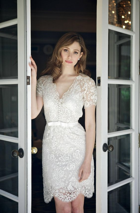 a delicate lace mini dress with a V-neckline, short sleeves and a scallop edge plus a sash is very chic and beautiful