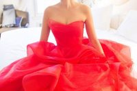 a gorgeous fiery red wedding ballgown with a strapless draped bodice, a layered skirt and a train is a beautiful color statement