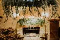 a large cascading greenery chandelier with LEDs can highlight a dance floor or a reception