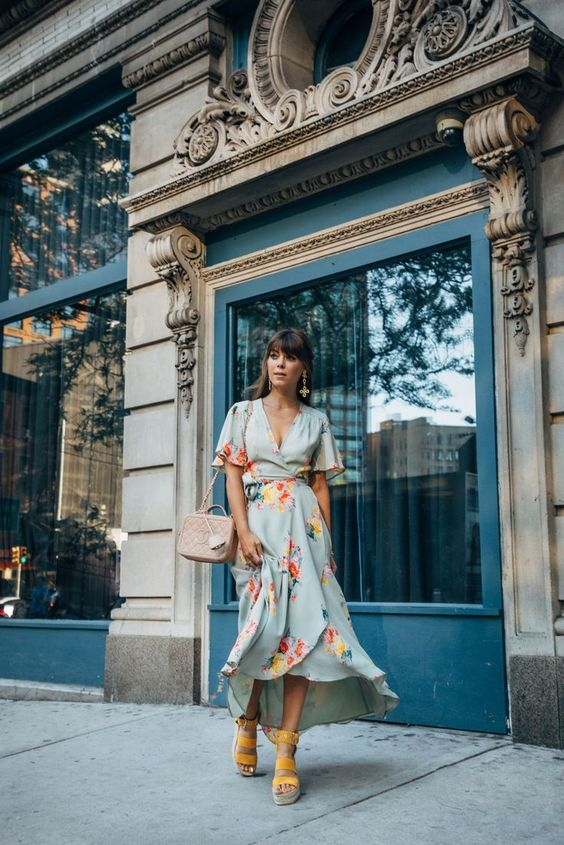 a light blue floral midi wrap dress, yellow platform shoes and a blush box bag for a bright look