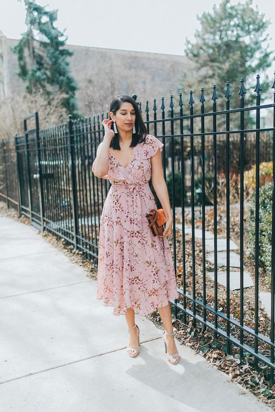 a light pink floral wrap midi dress with ruffle cap sleeves, grey shoes and a brown bag