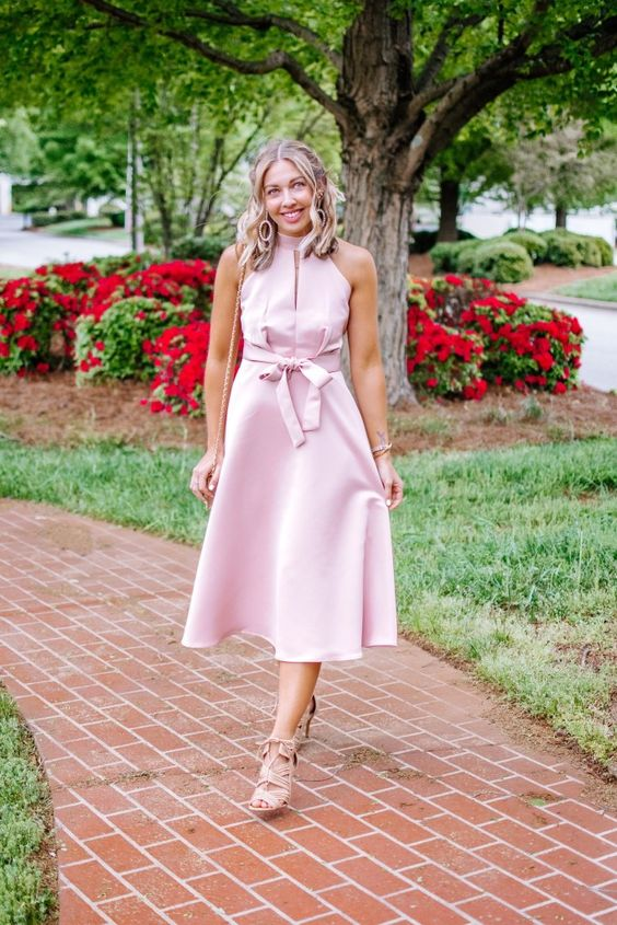 a light pink halter neckline midi dress, a bow, blush shoes and a bag for a cute and romantic outfit
