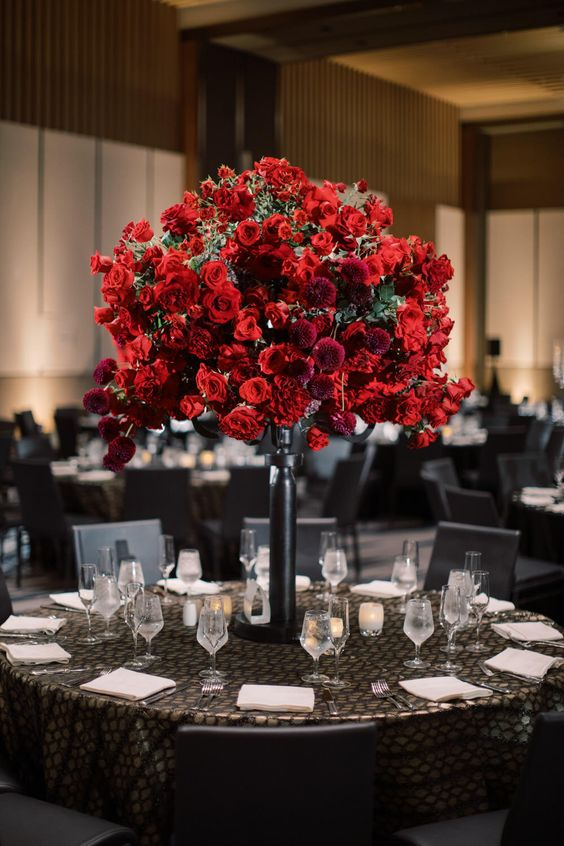 a lush and beautiful red rose wedding centerpiece with burgundy dahlias is a stunning idea for a Valentine's Day